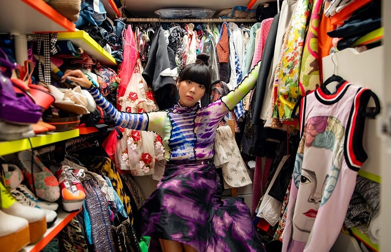 Susie Bubble in front of clothing. Image by Farfetch and Thrift+